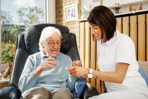 Nurse caring for elderly person
